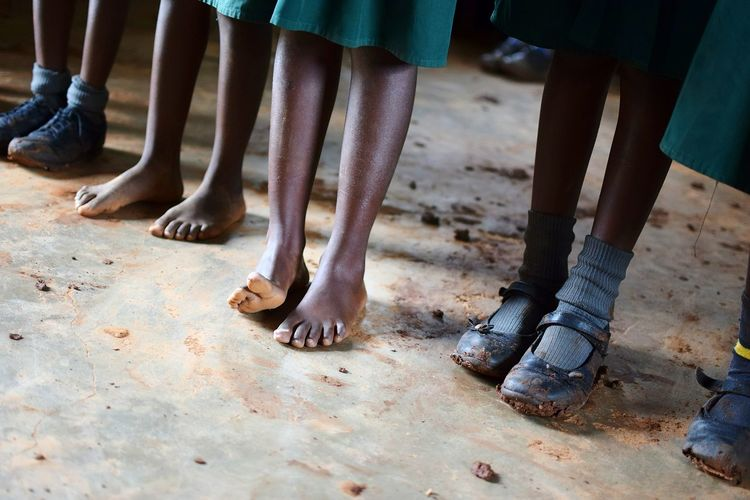 Low Section Of School Children With Shoes And Barefoot