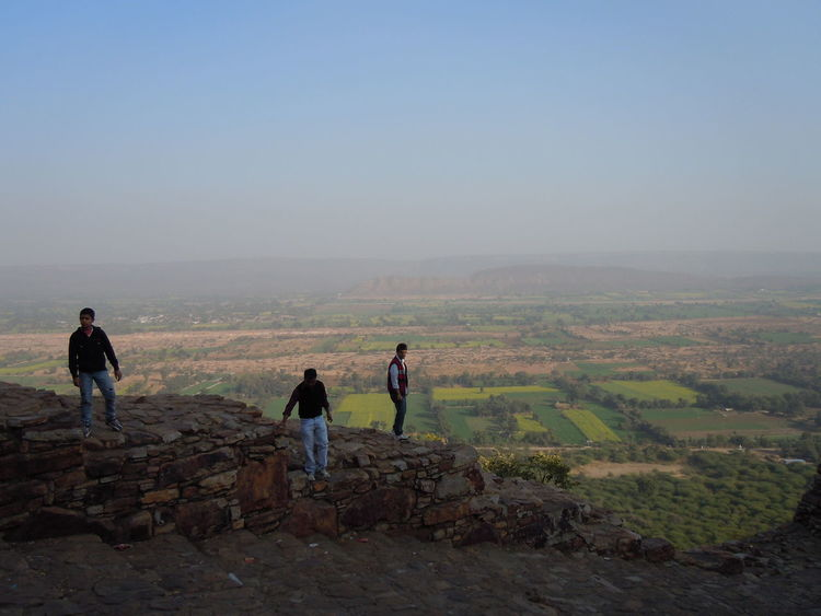 00613 Unesco World Heritage of India-Hill Forts of Rajasthan-Chittorgarh Fort-view from the fort Beauty In Nature Clear Sky Day Escapism Full Length Landscape Leisure Activity Lifestyles Looking Men Nature Non-urban Scene Outdoors Rear View Relaxation Remote Scenics Solitude Standing Tranquil Scene Tranquility