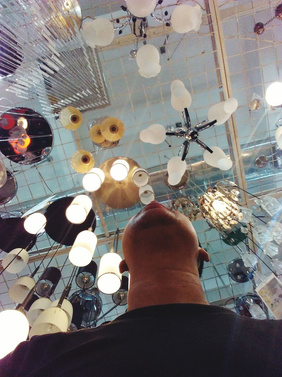 real people, indoors, low section, human leg, one person, personal perspective, ceiling, men, low angle view, illuminated, sitting, day, human body part, architecture, close-up, people