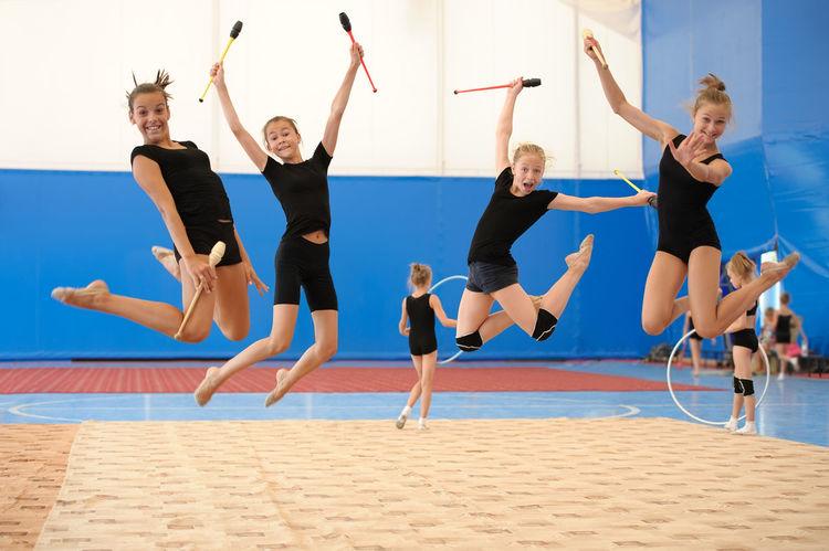 Caucasian Child Exercise Girl Group Gym Gymnast  Gymnastics Indian Club Jump Kid Pose Skills  Sport Sportive Sportsman Sportswoman Sporty Teen Teenager