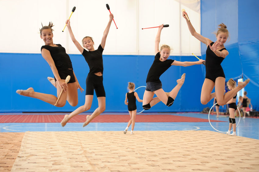 Caucasian Child Exercise Girl Group Gym Gymnast  Gymnastics Indian Club Jump Kid Pose Skills  Sport Sportive Sportsman Sportswoman Sporty Teen Teenager