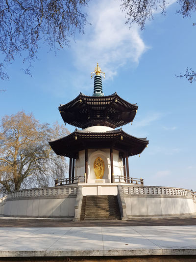 Japanese Buddhist Peace Pagoda temple in Battersea Park by the river Thames, London, UK Built Structure Architecture Sky Building Exterior Nature Cloud - Sky Belief Religion Building Tree Low Angle View Travel Destinations Place Of Worship No People Day Plant Spirituality Outdoors Tourism Spire  Pagoda Peace Pagoda Battersea Battersea Power Station Battersea Park