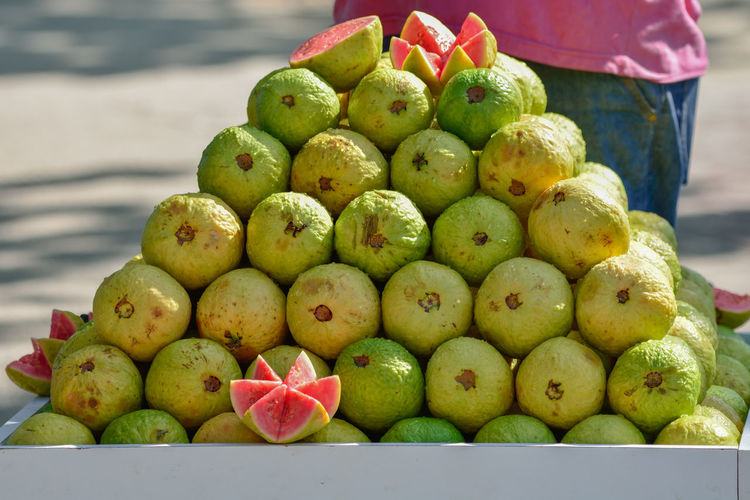 Close-up of guavas for sale at market stall