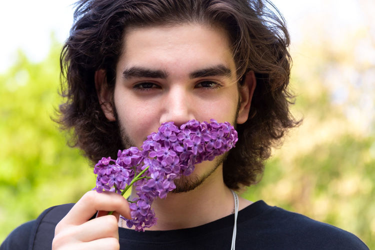 Young brunette guy smelling fresh flowers on lilac branch and looking at camera on blurred background Portrait Front View One Person Young Adult Leisure Activity Headshot Flowering Plant Flower Hairstyle Outdoors Purple Lilac Lilac Flower Smelling Smelling The Flowers Young Man Springtime Spring Brunette Handsome Handsome Boy Guy Park Branch Cute Curly Hair Looking At Camera Plant Close-up Nature Focus On Foreground Freshness Holding Hair Real People Flower Head Human Face My Best Photo The Portraitist - 2019 EyeEm Awards