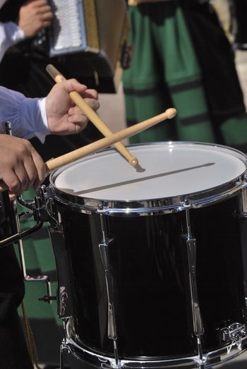 Cropped Hands Playing Drum