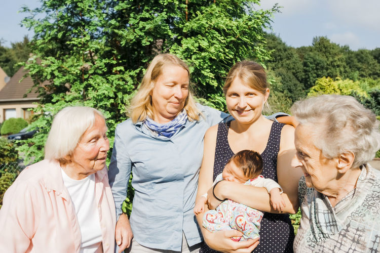 Family against plants in summer