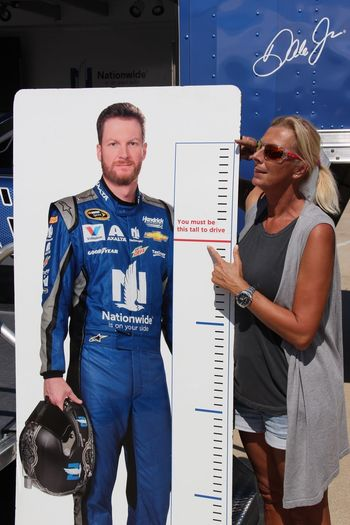 I'm tall enough for a race car driver... or maybe too tall??? 😂😂 Casual Clothing Text Three Quarter Length Communication Western Script Person Boys Childhood Standing Blue Leisure Activity Elementary Age Front View Young Adult Race Car Race Racing Size Matters Size Comparison
