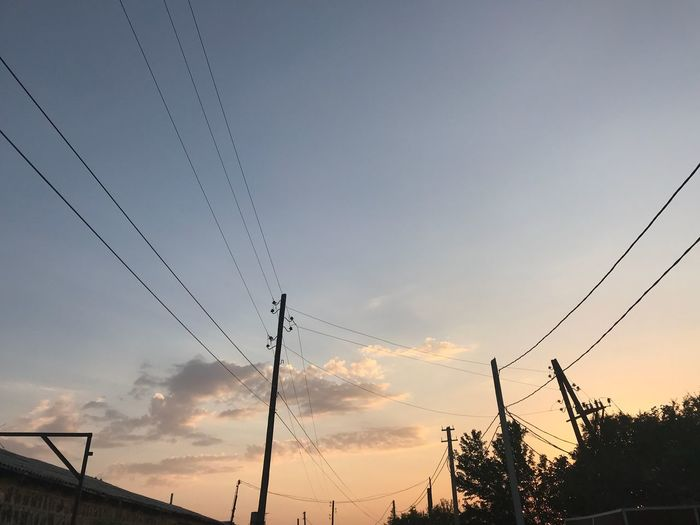 Calm sunset Sky Sunset Low Angle View Silhouette Nature Cloud - Sky No People Orange Color Beauty In Nature Connection Outdoors Electricity  Power Line  Cable Tree Plant