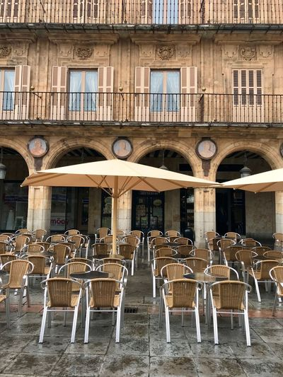 Sous la pluie Architecture Built Structure Building Exterior Chair Seat Day Building City Empty Table Arch No People