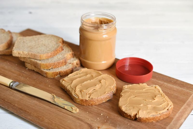 EyeEm Selects Bread Peanut Butter Food And Drink Food Freshness Table Cutting Board Still Life Indoors  Dairy Product Wellbeing Container No People Breakfast Preparation  Eating Utensil Household Equipment Bread Healthy Eating Meal SLICE Wood - Material