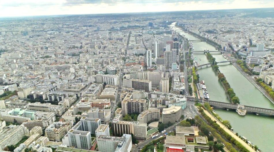 People Of EyeEm People And Places Battle Of The Cities Built Structure City Architecture Building Exterior Cityscape City Life Aerial View Travel Destinations River Skyscraper Outdoors Capital Cities  Development Modern Sky Financial District  Wide Shot Crowded Residential District Day Amour ❤ Paris ❤