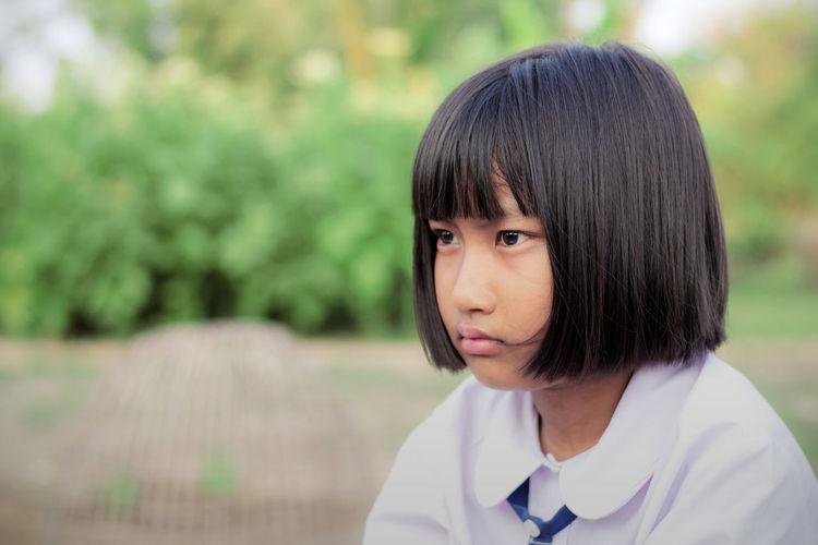 Close-up of girl looking away outdoors