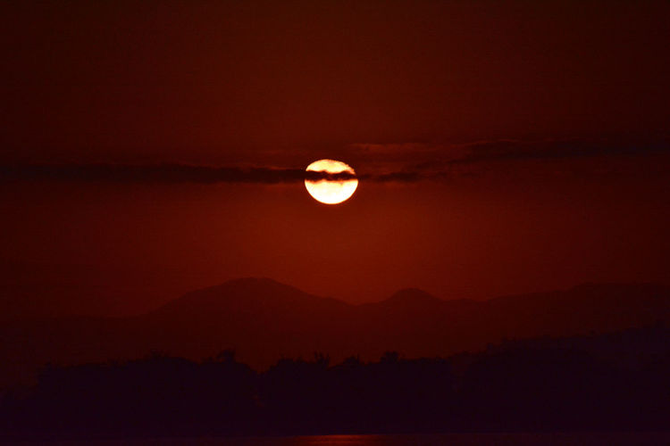 red moon Astronomy Beauty In Nature Circle Dark Full Moon Idyllic Majestic Moon Moon Moon Surface Moonlight Mountain Nature Night No People Outdoors Planetary Moon Red Moon Red Moon Night Red Moon Rising Scenics Sky Space Exploration Tranquil Scene Tranquility