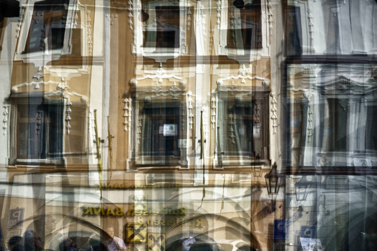 window, architecture, building exterior, reflection, day, built structure, outdoors, no people