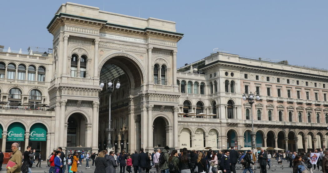 MILAN, ITALY- MARCH 7, 2017: Tourists walking and taking pictures with pigeons in Piazza Duomo of Milano fashion city. Ground view of this historic Gothic cathedral. tourists walking for shopping inside the Galleria Vittorio Emanuele II gallery in Piazza Duomo square. Famous fashion stores like Prada. Luxury and shopping concept. Cathedral Church City Duomo DuomoDiMilano Fashion Italia Milan Milan Italy Milan,Italy Milano Milano Italy Square Vittorio Emanuele II Vittorio Emanuele II Gallery Arch Architectural Column Architecture Building Exterior Built Structure Clear Sky Crowd Day Dome Duomo Di Milano Duomo Square Galley Group Of People History Italy Italy❤️ Large Group Of People Lifestyles Men Milanocity Outdoors Real People Sky Statigram The Past Tourism Tourist Travel Travel Destinations Women