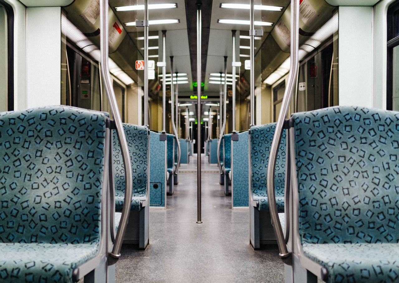Interior of illuminated empty metro train