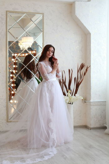 Newlywed Bride Wedding Women One Person Celebration Real People Looking At Camera Full Length Event Adult Young Adult Fashion Beautiful Woman Portrait Wedding Dress Smiling Beauty Lifestyles Young Women Hairstyle Flower Arrangement Bouquet