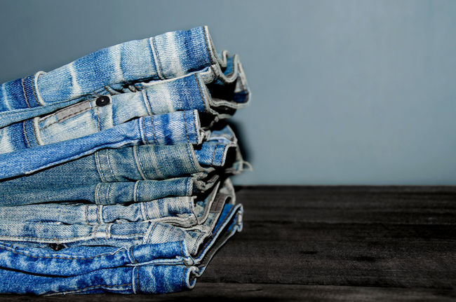Blue jean and jean lack texture on the wooden floor, Pattern of blue jeans are overlapping on the table and free space. Jeans Blue Blue Jeans Casual Clothing Close-up Day Fashion Indoors  Jean Jeans Jeans Lack Lack No People Overlap Overlapping Pattern Studio Shot Textile Texture Wooden