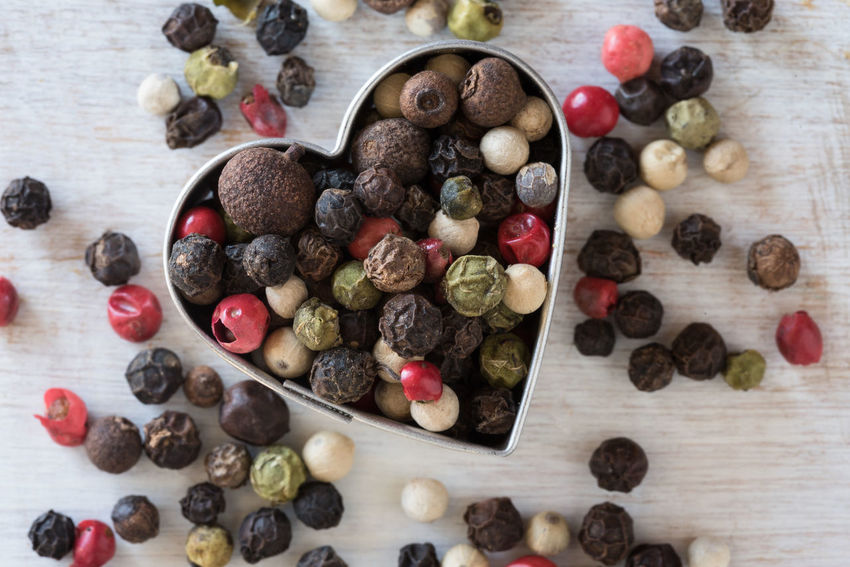 Multi-colored Whole Peppercorns Colored Love Peppercorns Shape Valentine's Day  Close-up Dried Food Heart High Angle View No People Seasoning Spice Variation