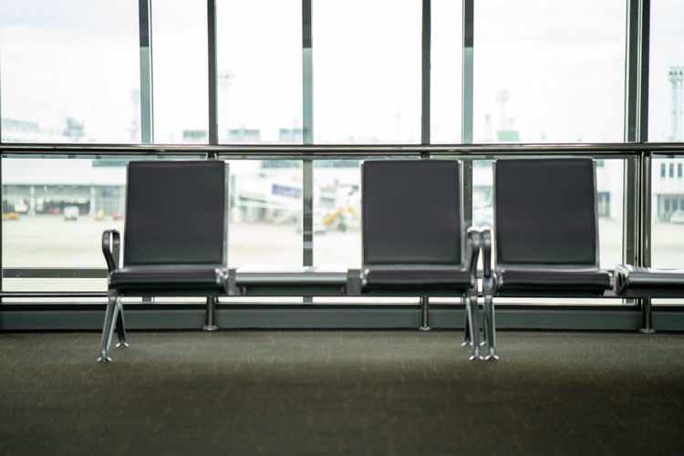 Absence Airport Airport Departure Area Airport Terminal Business Chair Day Empty Furniture Glass - Material Indoors  Lobby No People Seat Table Transparent Transportation Travel Waiting Window