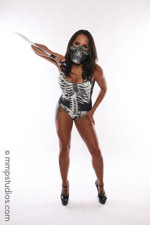 @mmpstudios_com @melvinmaya Skeleton Skull Mask Knife Blade Halloween Spooky Scary Horror Photographer Model Photography Cannon Studio Shot White Background Front View Full Length Adult Standing HighHeels Brunette Gorgeous Beautiful
