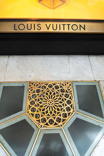 Louis Vuitton store. Shortened to LV, Louis Vuitton Malletier is a French fashion house and luxury retail company located in the Galleria Vittorio Emanuele II in Milan, Northern Italy Boutique Fashion Louis Vuitton Shopping Shopping ♡ Brand Communication Fashion Photography Fashionable French Louis Vuitton Fashion Luxury No People Retail  Shop Shopaholic Shopping Mall Sign Store Text Vuitton