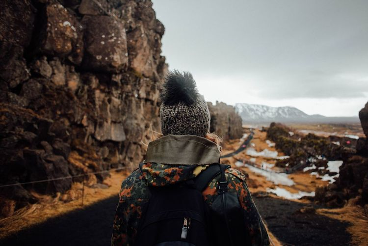 Rear View Of Woman Standing At Pingvellir National Park During Winter