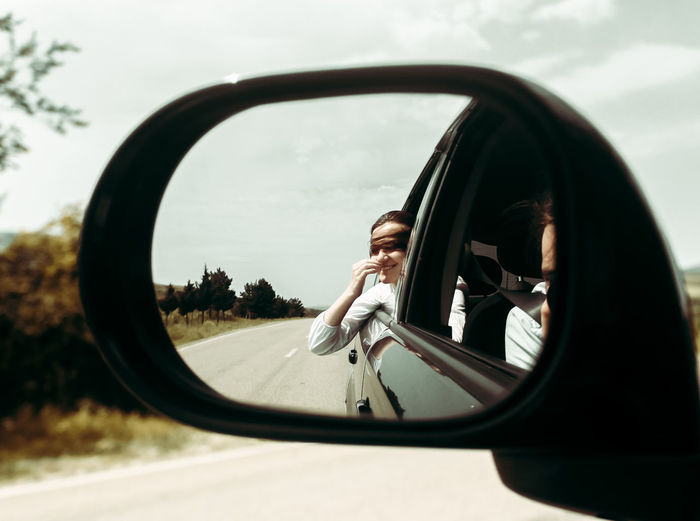 Reflection of car on side-view mirror