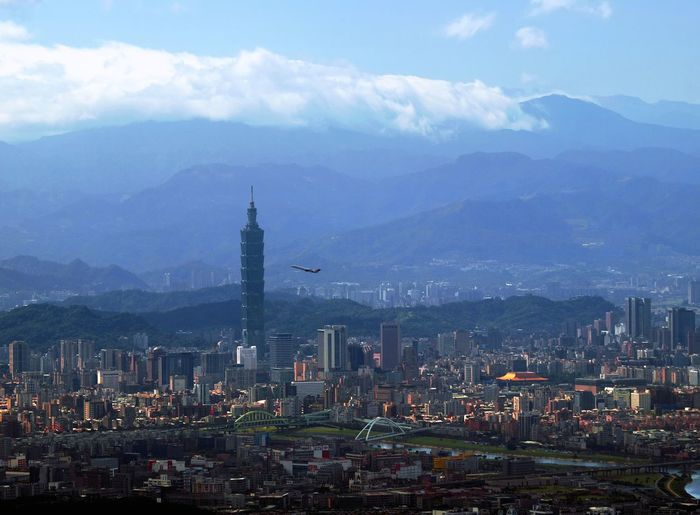 Sunlight shining on Taipei's 'East District'. The mountains in the background are New Taipei's Shiding and Wulai districts, rising to an elevation of 2,000 metres. East District Sunlight Taipei 101 Taipei City Taipei,Taiwan Architecture Built Structure City Cityscape Modern Mountain Mountain Range Nature New Taipei City Outdoors Skyscraper Tall Tower Urban Skyline
