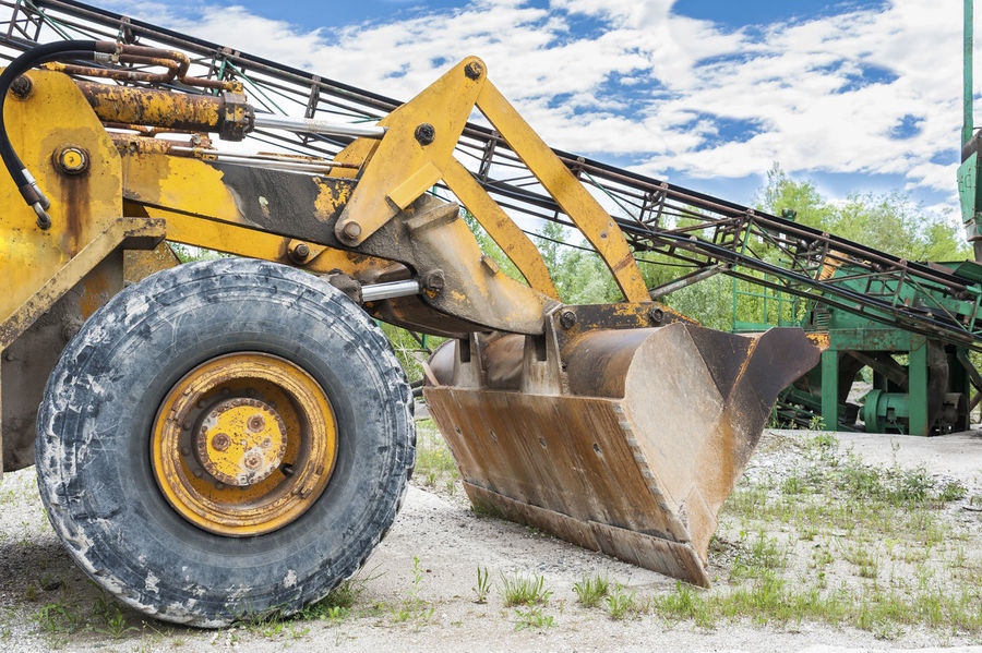 Old yellow bulldozer, for the displacement of the gravel Blade Building Buldozer Construction Equipment Excavator Industry Quarry Too