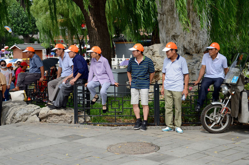 Casual Clothing Consistency Leisure Activity Lifestyles Medium Group Of People Orange Hat Persistency Repetition