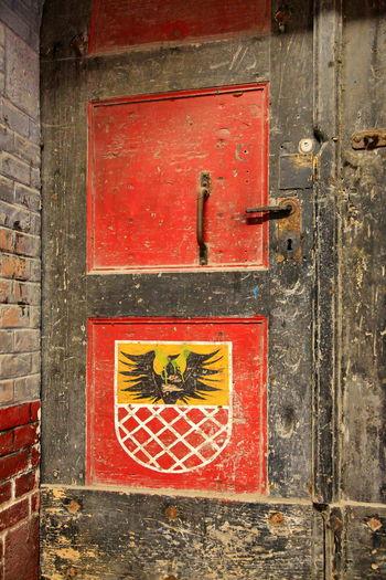 Close-up of red closed door