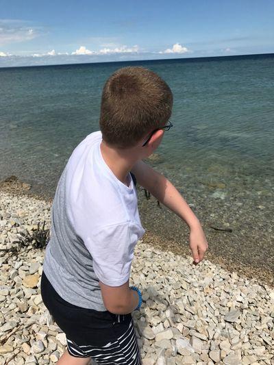 Boy Standing At Beach
