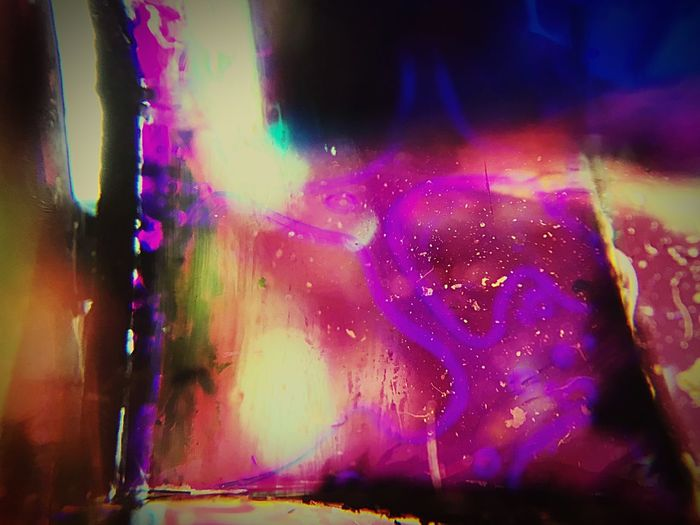 The Figure in the Glass Dichroic Borosilicate Glass Abstract Multi Colored Night Illuminated Indoors  No People Close-up
