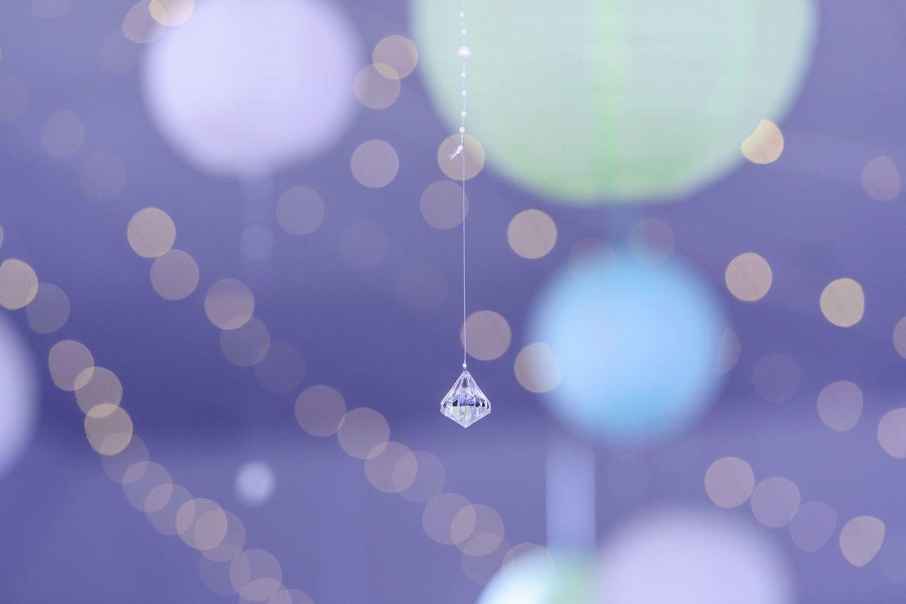 Pendant hanging against defocused lights