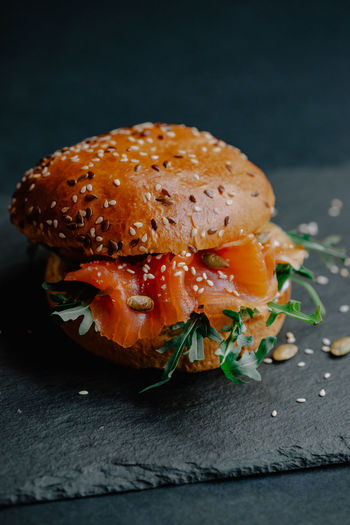 Close-up of burger against black background