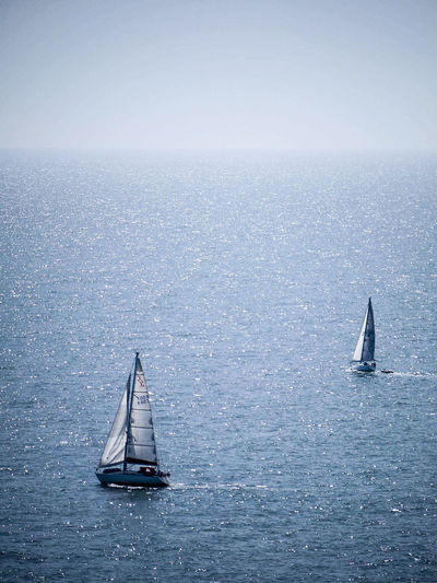 High angle view of sailboats in sea against sky