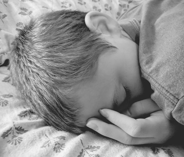 Close-up of boy sleeping on bed