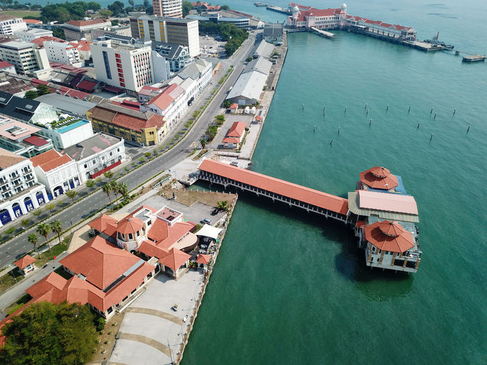 High angle view of harbor by buildings in city