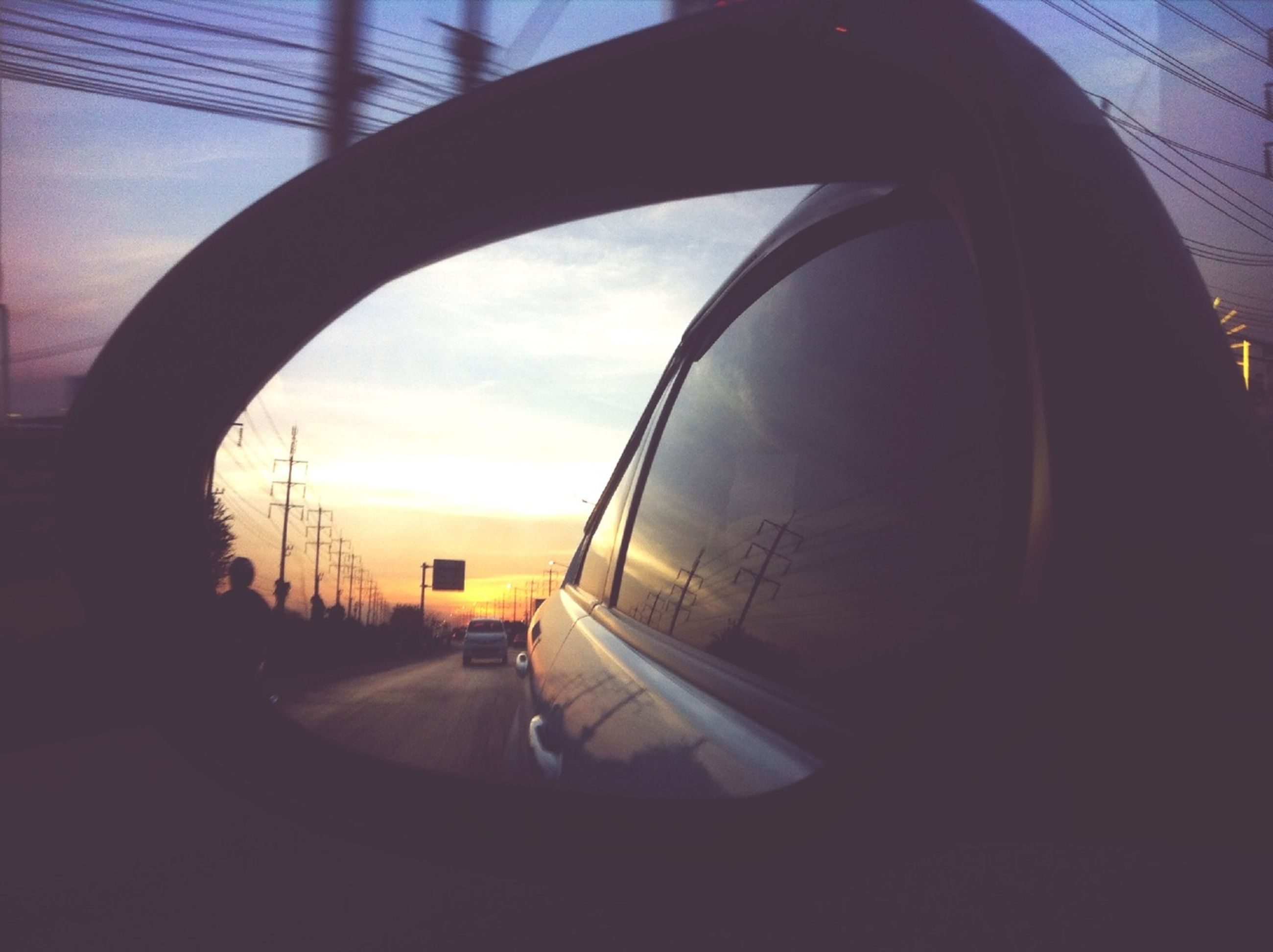 transportation, sky, built structure, architecture, mode of transport, indoors, cloud - sky, sunset, window, glass - material, car, cloud, travel, vehicle interior, transparent, no people, reflection, silhouette, arch, building exterior