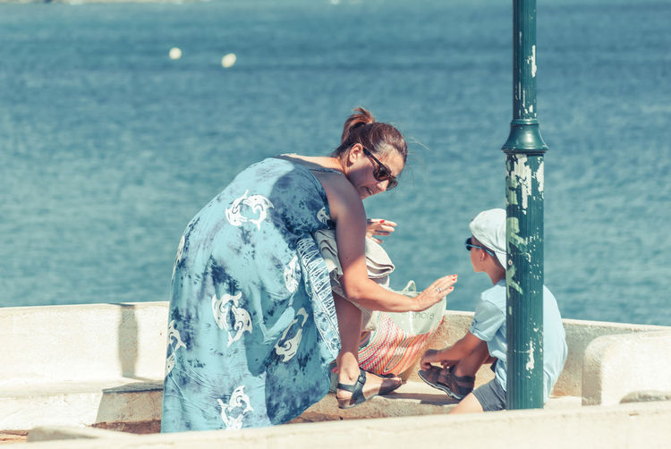 Loving mother and son at observation point by sea