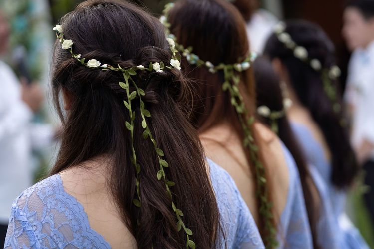 Bridesmaid Adult Braided Hair Brown Hair Celebration Day Event Flower Focus On Foreground Group Of People Hair Hairstyle Headshot Human Hair Incidental People Long Hair Outdoors Portrait Real People Rear View Togetherness Wearing Flowers Women