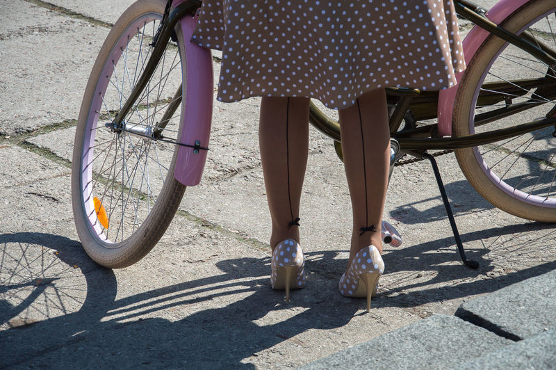 Low section of woman with bicycle