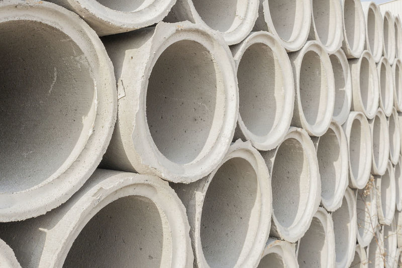 Full frame shot of stacked concrete pipes