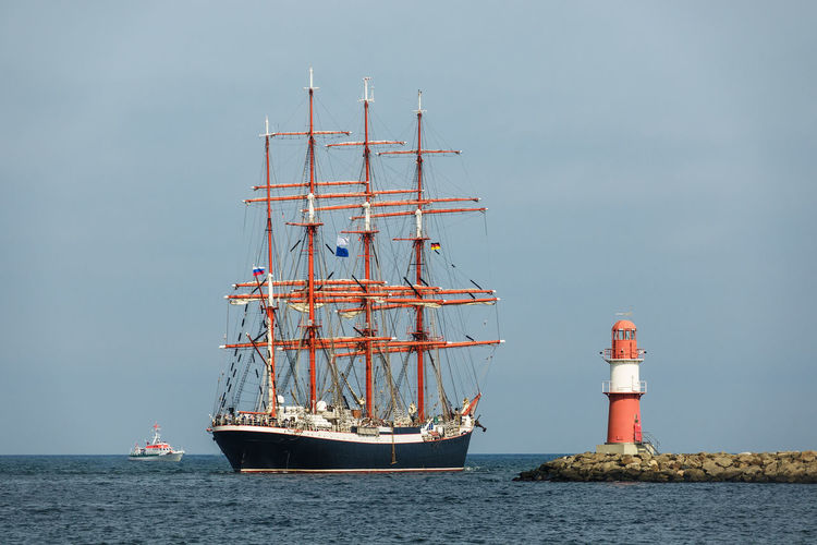 Sailing ship in Warnemuende, Germany. Baltic Sea Hanse Sail Holiday Lighthouse Maritime Rostock Sailing Ship Tall Ship Travel Warnemünde Coast Horizon Over Water Journey Mole Nautical Vessel No People Outdoors Sailing Boat Shore Sky Tourism Transportation Vacation Water Windjammer