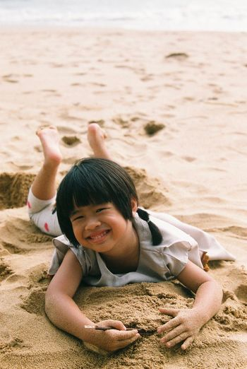 Enjoy The sand. Filmisnotdead Film Photography Film Girl Beach Sand Child Childhood Nature Smiling Innocence Outdoors Happiness First Eyeem Photo This Is Natural Beauty