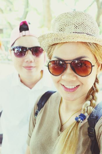 Close-up portrait of female friends wearing sunglasses while standing outdoors