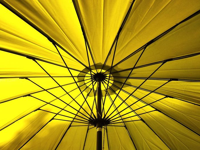 Low angle view of yellow ceiling