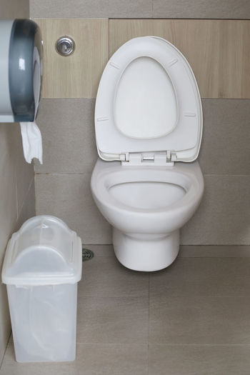Modern Toilet bowl in a men bathroom,white ceramic flush toilet for men in toilet room. Toilet Bathroom Hygiene Indoors  Toilet Bowl White Color No People Domestic Room Domestic Bathroom Convenience Home High Angle View Flooring Flushing Toilet Absence Urgency Clean Tile Seat Close-up Toilet Toilette Bowl Bowls Bathroom Pic