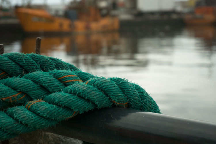 Close-up of rope on boat over lake